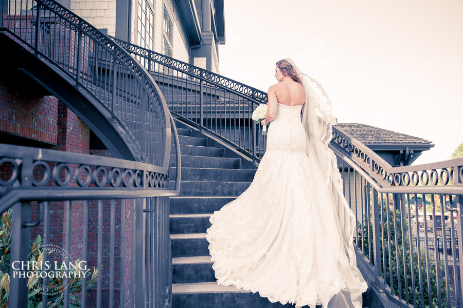 Image of River Landing staircase and a bride in her wedding dress.