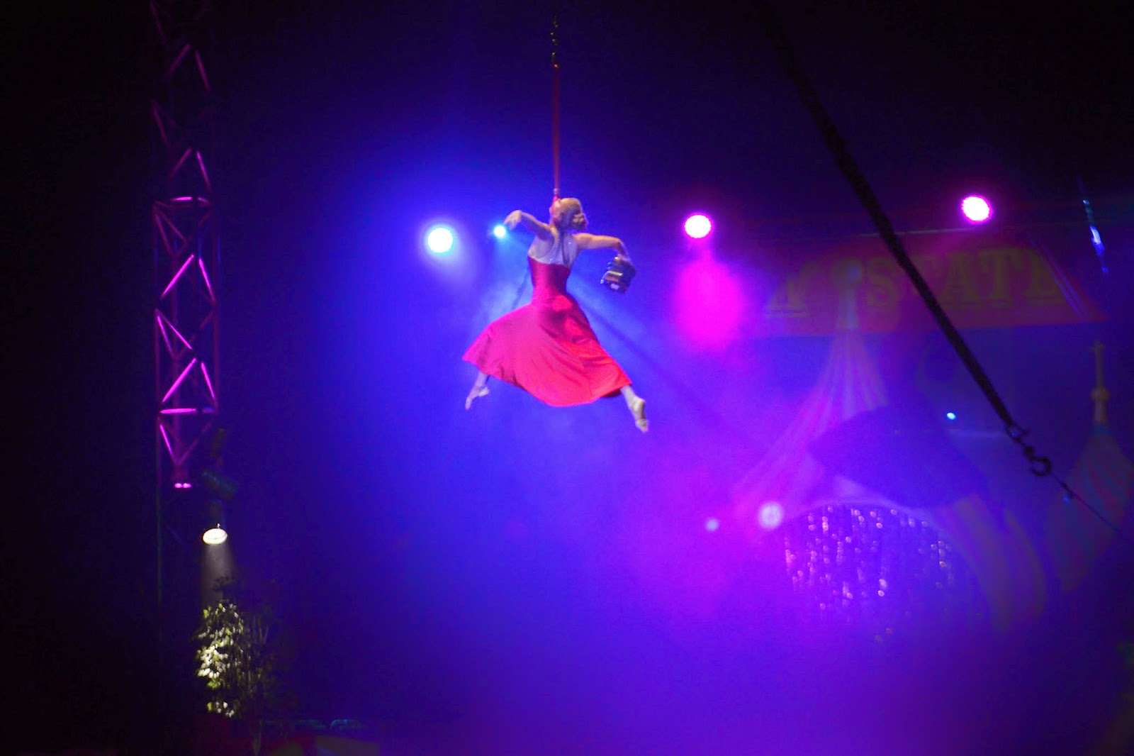 a circus act where the performer is suspended in the air