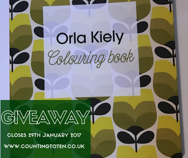 Image of an Orla Kiely Colouring Book with green flours on covered in a text box saying: Giveaway closes 29th January 2017 www.countingtoten.co.uk