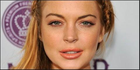 Lindsay Lohan Golpea Pasajero Con su Porche