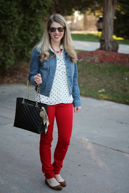 red jeans, polka dot top, denim jacket, leopard flats