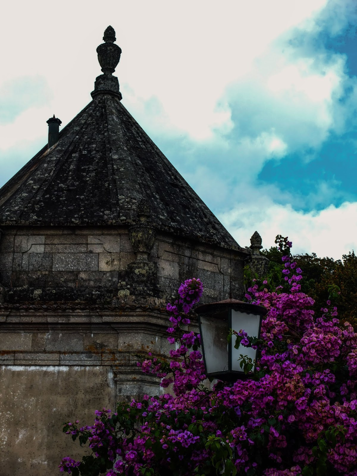 A chapel with pink flowers from Bom Jesus do Monte Sanctuary in Braga, Portugal.