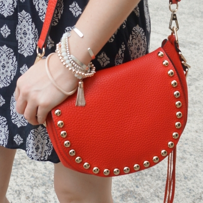 mixed metal bracelet stack, navy dress, Red Rebecca Minkoff studded saddle bag | awayfromtheblue