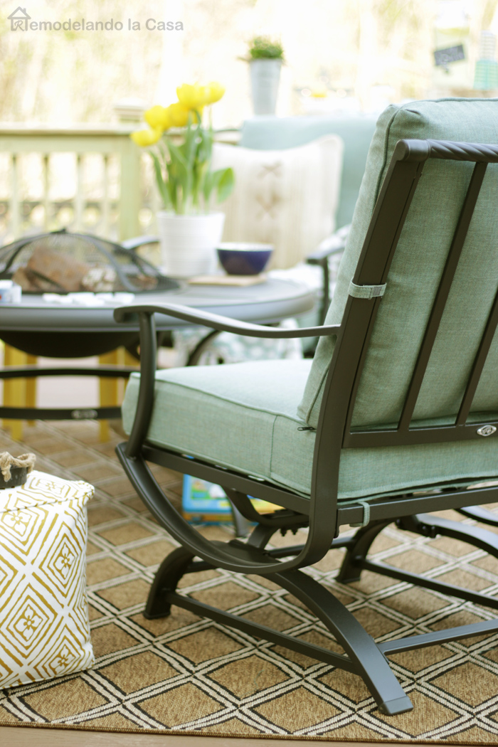 a drab backyard space is transformed with the addition of a deck and new outdoor furniture