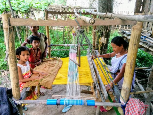 Mekhla and Chadar being woven by Mishing tribal women, Assam