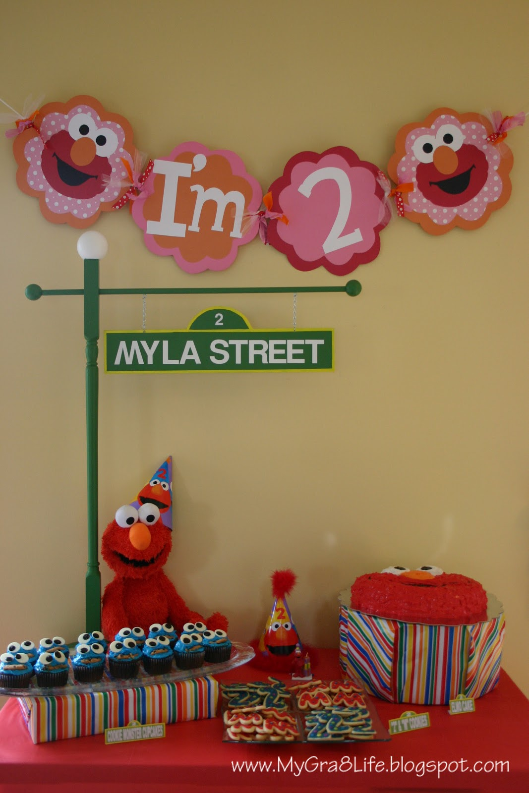 Above Is The Completed Look Of Dessert Table Including Banner Myla Street Sign Cake Cupcakes Cookies And Stuffed Elmo