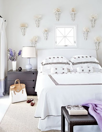 wall sconces with corals in bedroom