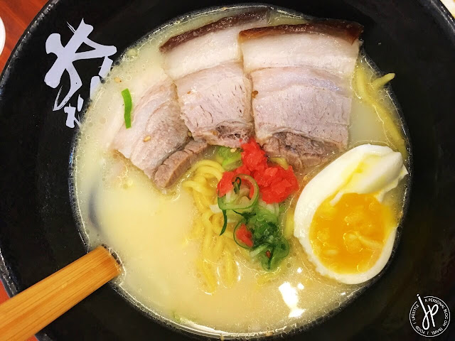 light ramen with three slices of pork and half egg