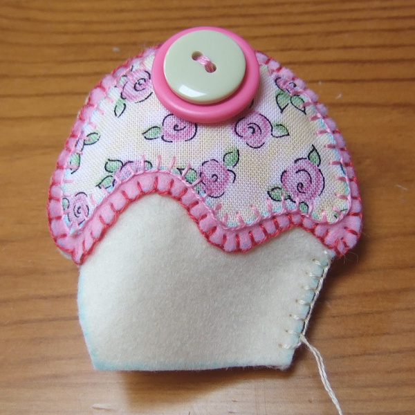 Stitching the edges of a felt ornament plush while filling with fiber