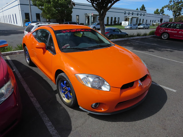 Custom orange paint job on 2006 Mitsubishi Eclipse from Almost Everything Auto Body.