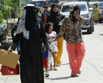 Christians escape Philippines hijab borrowed