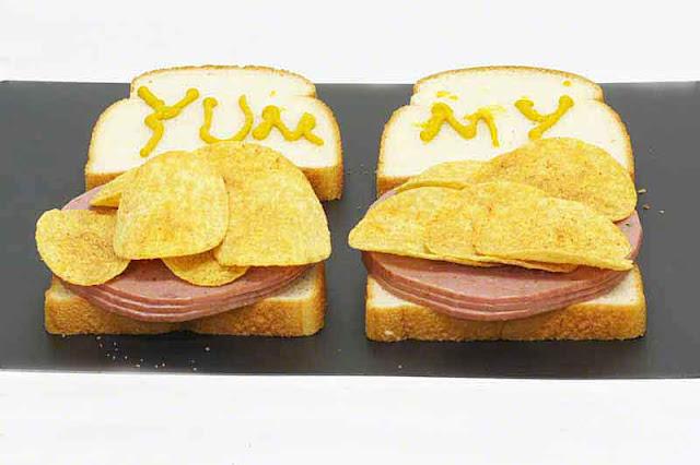 sandwiches, salami, mustard, potato chips