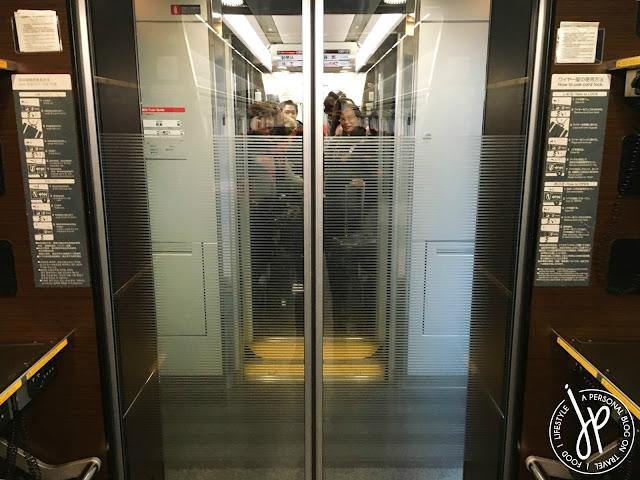 train glass door, group of people looking