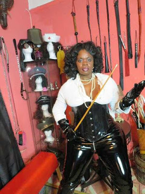 femdom dominatrix mistress bdsm holding a long cane