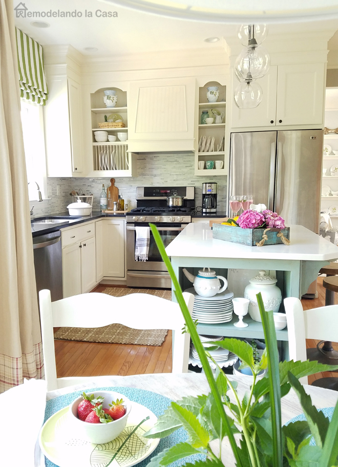 coastal kitchen  green roman shade - open cupboards