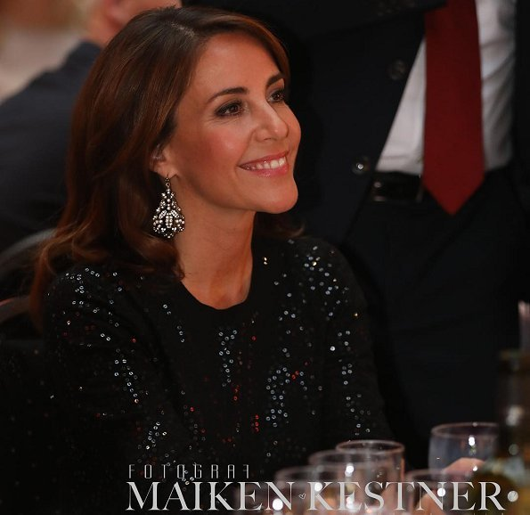 Princess Marie wore Marchesa notte Long-sleeved tops. Generation Love Black Glitter Mesh Long Sleeve Sweater and trousers, gold earrings