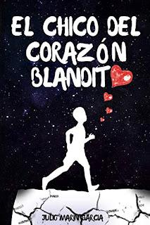Portada de la novela El chico del corazon blandito de Julio Marin Garcia novela romantica en la que se ve un chico caminando sobre un suelo rasgado y con un corazon palpitandole