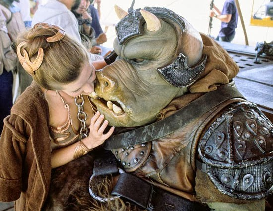 Gamorrean Guard being kissed by Carrie Fisher