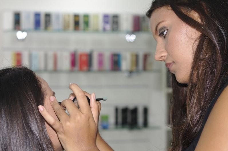 Choosing Your Best Eyeliner Colors for Skin Tone Makeup Artist using eyeliner color on a client