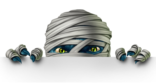 Cartoon image of a mummy peeking over an edge