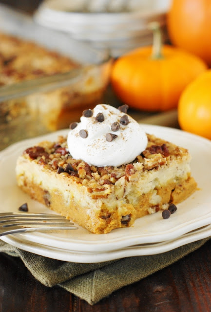 Chocolate Chip Pumpkin Dump Cake makes it easy to join together the fabulous Fall flavor combination of pumpkin and chocolate.  It's so good, it'll have you singing to it's chocolate-y pumpkin deliciousness!