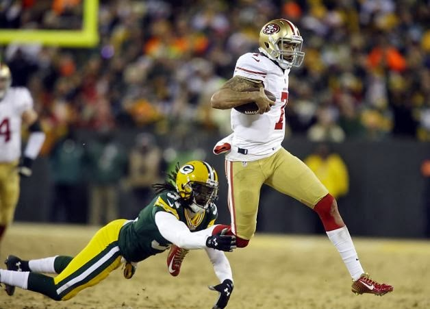 http://www.sfgate.com/49ers/article/Kaepernick-bares-arms-tats-toughness-for-victory-5116735.php#photo-5683667