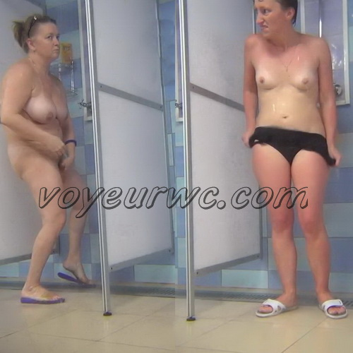 A hidden camera in a public shower films gorgeous women while they soap up their bodies (Hidden Camera Public Shower 199-208)