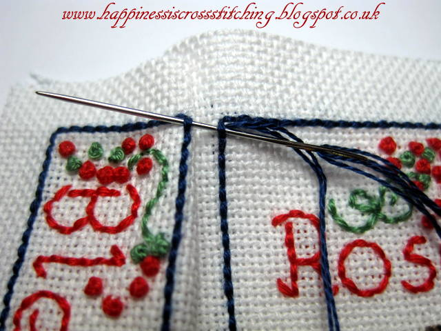Close up showing how to stitch the border of this cottage cross stitch to make a mattress pincushion