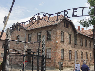 "The German phase ""Arbeit Macht Frei"" meaning ""work sets you free"" seen above the entrance to Auschwitz. This is a replica of the original but it's said that the sign was made by prisoners who inverted the ""B"" in an act of defiance. (Photo courtesy of Alvin C.)"