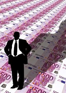 emprendedor sobre muchos euros