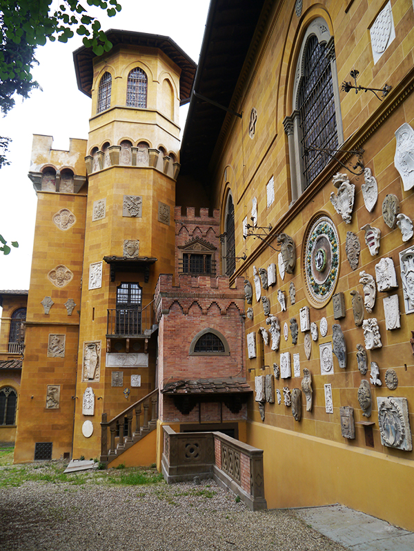 The facade of the Stibbert Museum in Florence, Italy, shows off its collection of crests