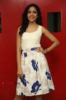 Actress Ritu Varma Stills in White Floral Short Dress at Kesava Movie Success Meet .COM 0159.JPG