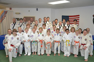 Families practicing martial arts together