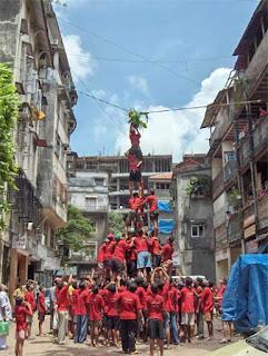 Govindas forming a human pyramid  to reach the Dahi Handi, Wikipedia