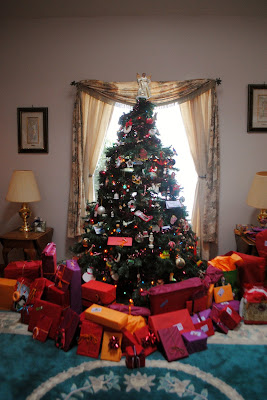 big christmas tree with beautiful gifts underneath