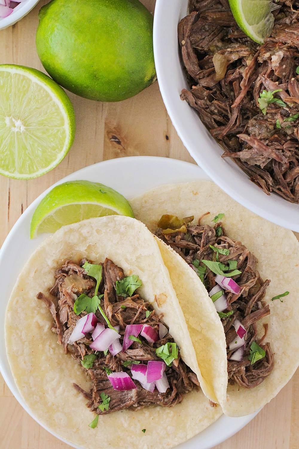 These juicy and flavorful Instant Pot barbacoa tacos are so delicious and easy to make, too!