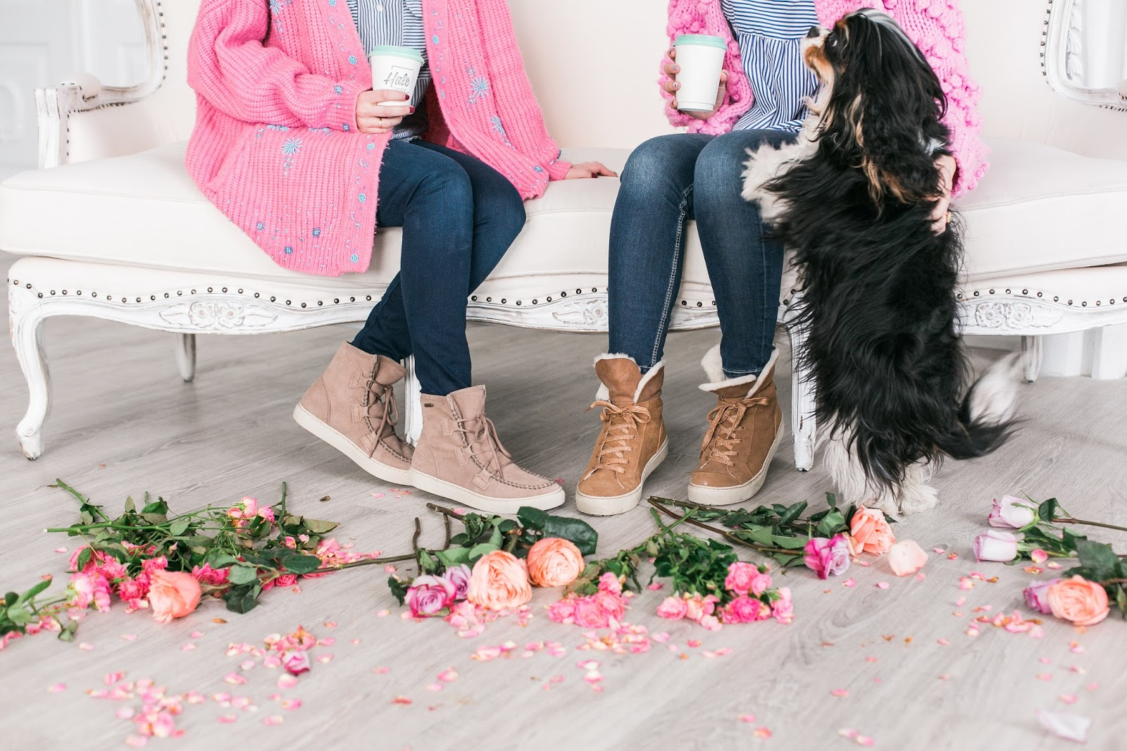 Bijuleni | 2 Transitional Boots You Need For Spring | Sisters wearing matching pink cozy sweaters, skinny jeans and striped shirt and Cavalier King Charles tri colour puppy
