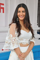 Telugu Actress Amyra Dastur Stills in White Skirt and Blouse at Anandi Indira Production LLP Production no 1 Opening  0069.JPG