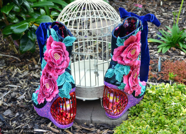 back view of Irregular Choice Maya birdcage heeled boots in garden