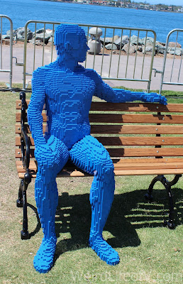 Lego man sitting on a park bench advertising an exhibit at the Ruben H. Fleet Science Center
