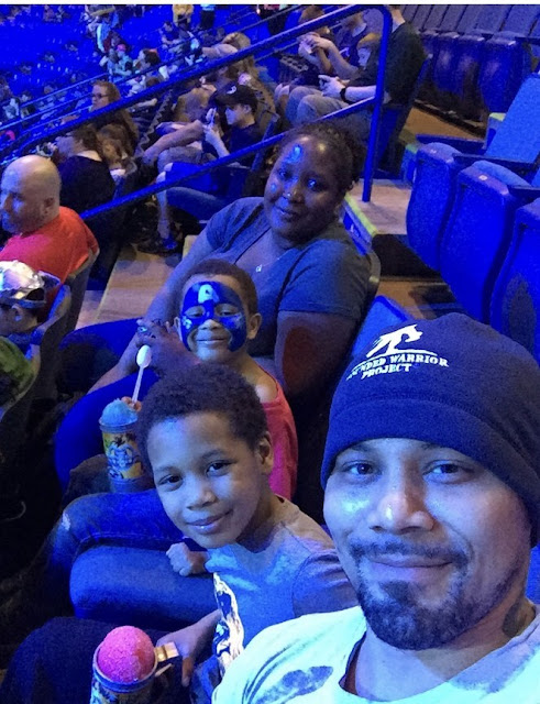 Army National Guard veteran Jason Bowden and his family gather during Marvel Universe Live