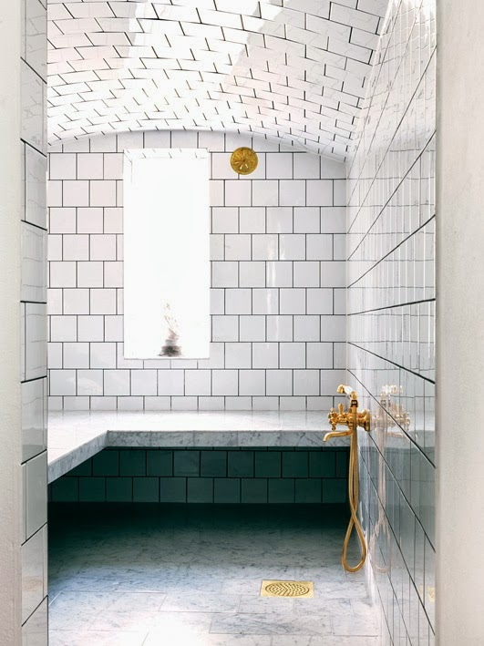 white bathroom with marble and white tiles