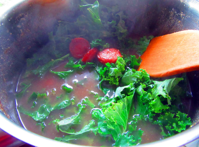Cornmeal soup with collard greens and sausage by Laka kuharica: stir in reserved sausages and collards.