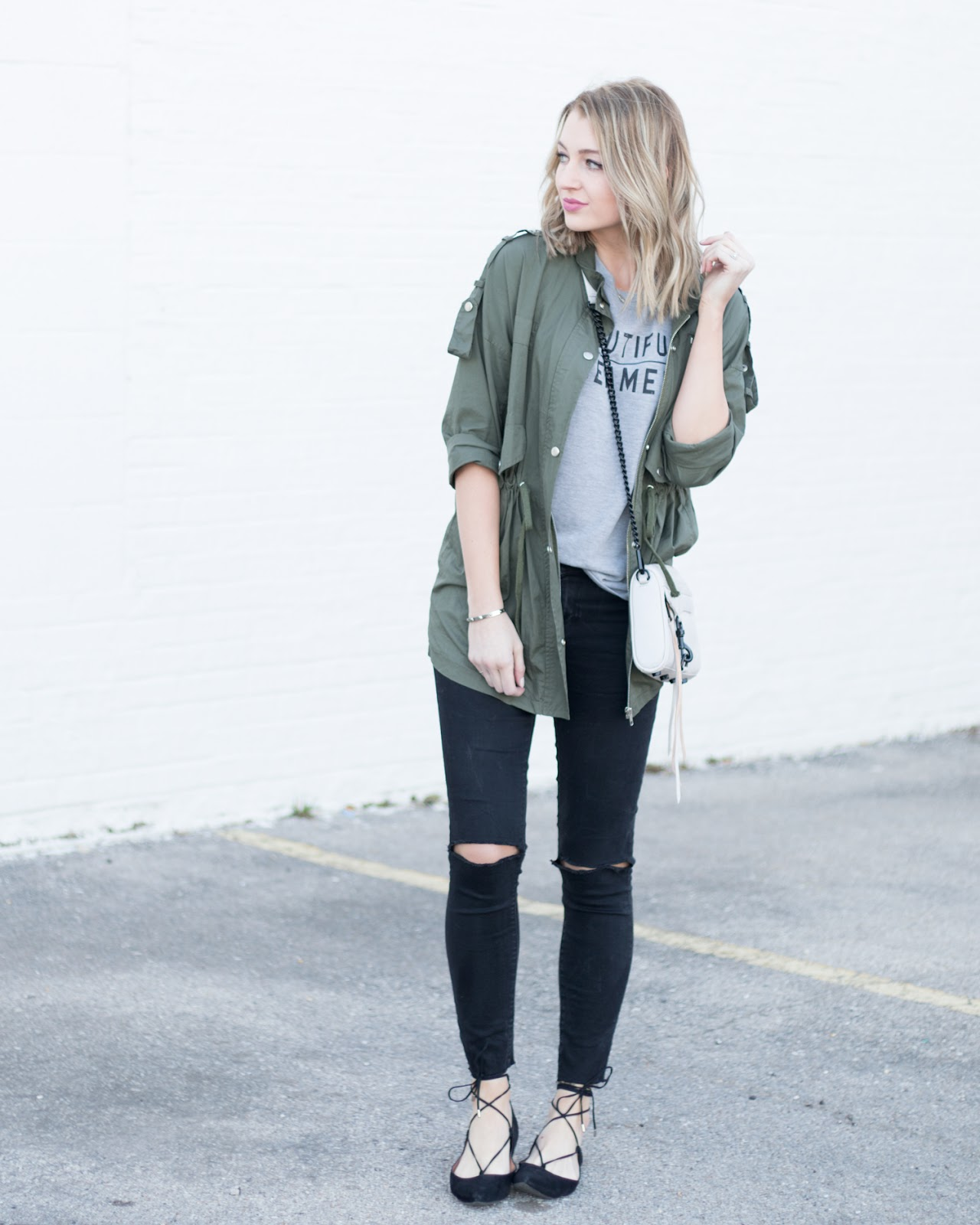 Utility jacket with distressed jeans