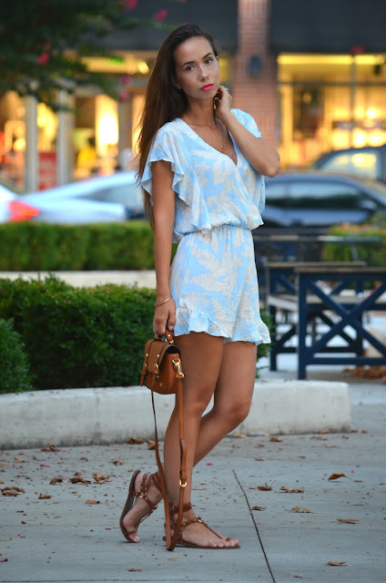 light blue printed H&M romper flutter sleeve.