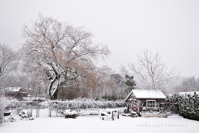My snowy back yard via Funky Junk Interiors