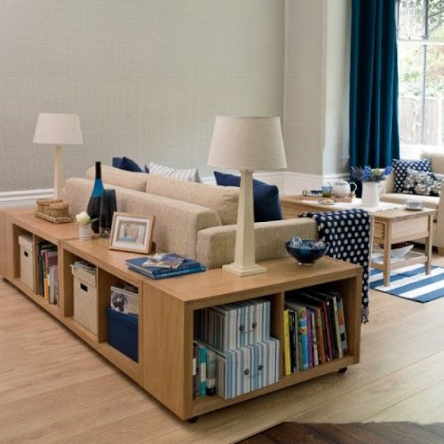 minimalist l shaped wood sofa table with storage cabinets on the laminate wood floor with two white table lamps