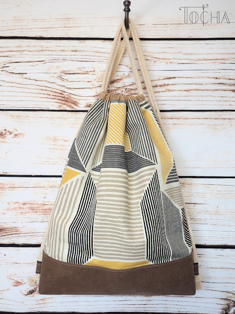 drawstring bagpack, rucksack, bag, duffel bag, duffle bag, Ikea, cotton, washpapa, washable kraft paper, Better Cotton Initiative, durable paper, cotton canvas, Birket, rope,