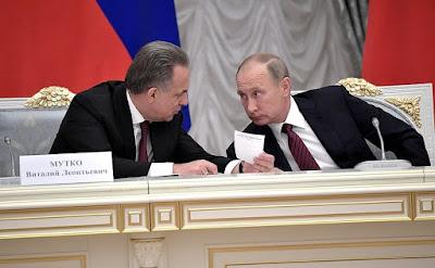 Vladimir Putin and Vitaly Mutko.