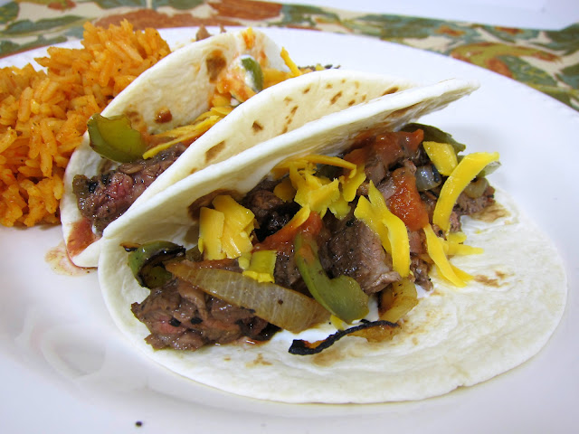 Rotel Fajitas - THE BEST fajitas! SO easy and CRAZY good! Marinate chicken or skirt steak in Rotel, beer, lemon juice, Worcestershire, garlic and pepper. Add onions and peppers to the skillet for great flavor. Our favorite Mexican recipe!